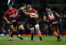 Scarlets' James Davies under pressure from Dragons' Zane Kirchner<br /> <br /> Photographer Simon King/Replay Images<br /> <br /> Guinness PRO14 Round 21 - Dragons v Scarlets - Saturday 28th April 2018 - Principality Stadium - Cardiff<br /> <br /> World Copyright © Replay Images . All rights reserved. info@replayimages.co.uk - http://replayimages.co.uk