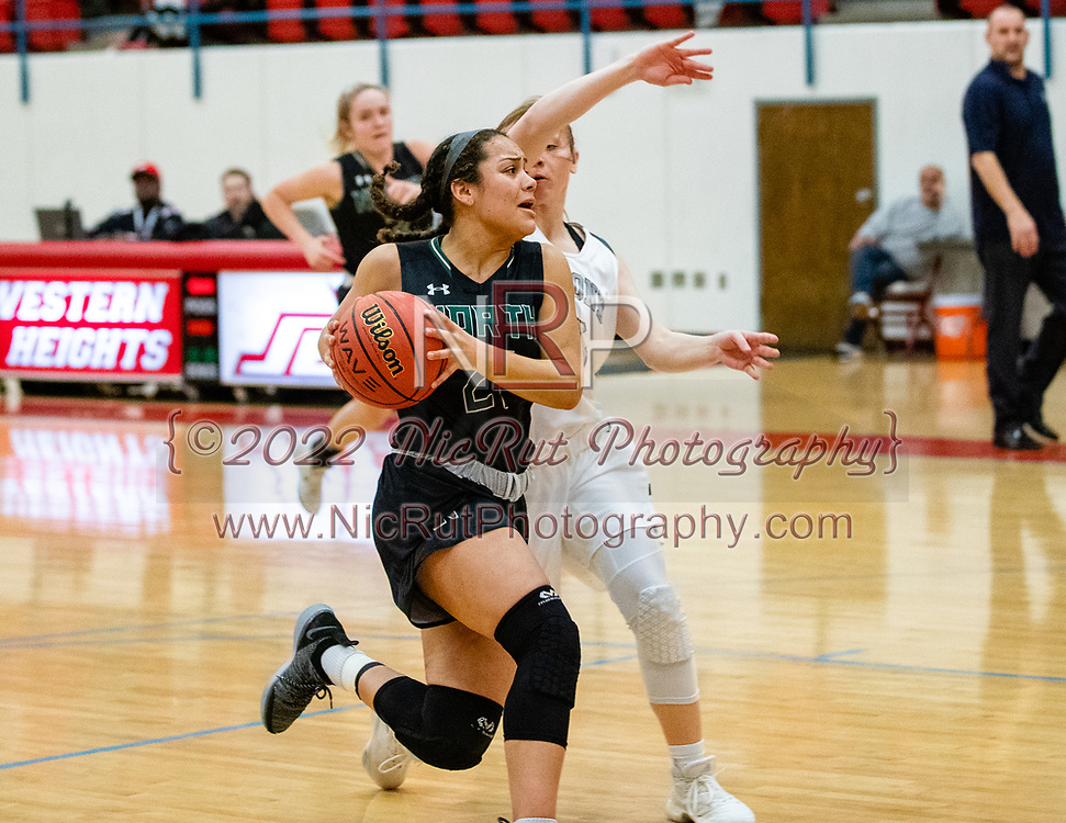 Norman North's Jacie Evans driving the basketball passed the Huskies defense during their game on Saturday, March 02, 2019 at Western Heights.