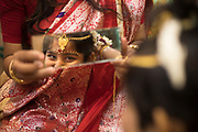 Though Rini is very much interested to enact her role as the Kumari, but the lengthy procedure of applying make-up made her impatient. She kept asking, 'How long it will take to finish?' Finally, after all her jewellery is put on, she is given a look in the mirror.