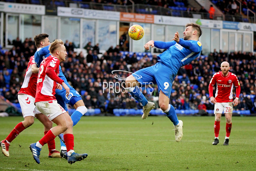 Peterborough Utd forward Matthew Godden (9) struggles to get this header on target during the EFL Sky Bet League 1 match between Peterborough United and Charlton Athletic at London Road, Peterborough, England on 26 January 2019.