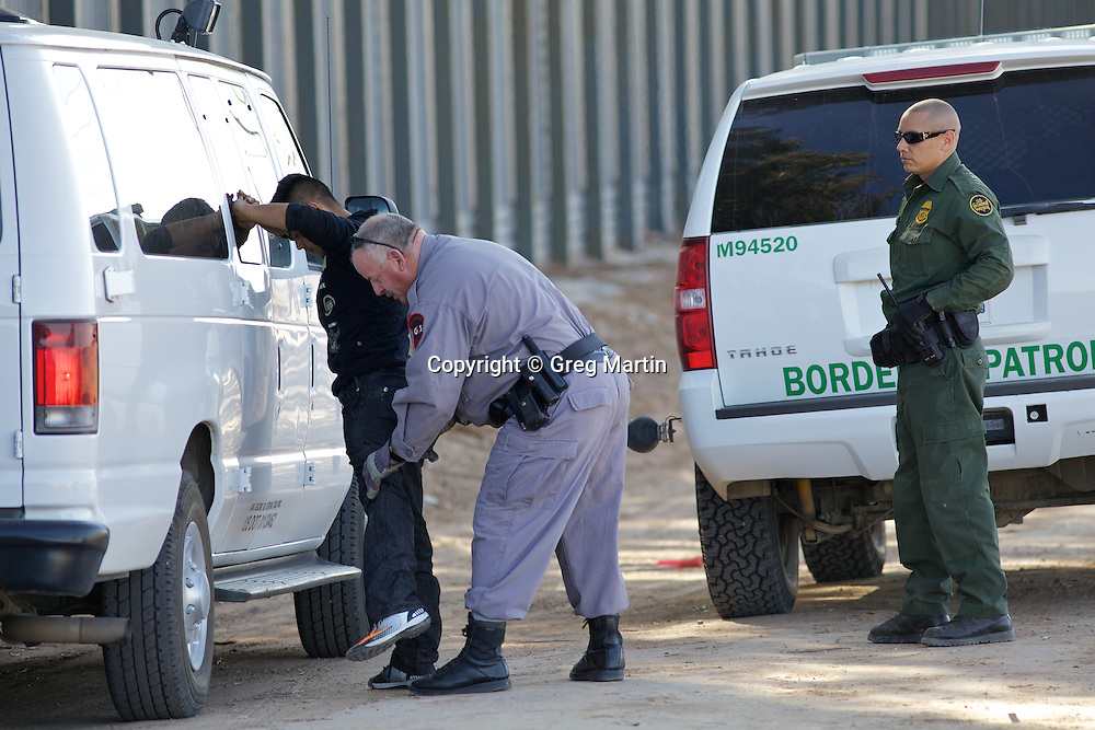 Illegal entry arrest at the US-Mexican border at Calexico, California, Imperial Valley, editorial only
