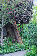 The tree house in The RHS Back to Nature Garden, Designed by HRH The Duchess of Cambridge with Andree Davies and Adam White - Press preview day at The RHS Chelsea Flower Show.