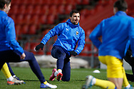 Cheye Alexander of AFC Wimbledon warming up during the EFL Sky Bet League 1 match between Doncaster Rovers and AFC Wimbledon at the Keepmoat Stadium, Doncaster, England on 26 January 2021.