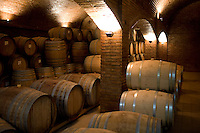 Oak casks, that contain sparkling wine, are stacked together in the winery at Bodega Chandon in Mendoza, Argentina.