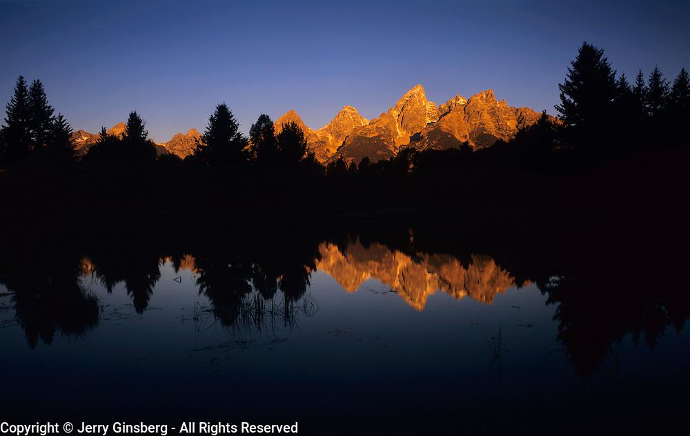 Teton range rises sharply into the Wyoming sky, Grand Teton National Park, WY.