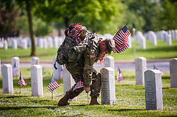 May 23, 2019 - Arlington, Virginia, U.S. - Soldiers assigned to the 3d U.S. Infantry Regiment (The Old Guard) place US flags on graves at Arlington National Cemetery ahead of Memorial Day in Arlington, Virginia. (Credit Image: © Michael A. McCoy/ZUMA Wire)