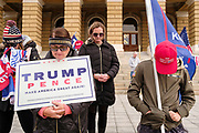 """21 NOVEMBER 2020 - DES MOINES, IOWA: People pray for US President Donald Trump during a """"Stop the Steal"""" rally at the Iowa State Capitol. About 100 supporters of President  Trump gathered at the Iowa State Capitol to rally in support of the President and in opposition to the outcome of the US election. They are a part of the """"Stop the Steal"""" movement which has spread across the US. This is the third week that there have been """"Stop the Steal"""" rallies across the US. Most independent observers and election officials, both Republican and Democratic, have said the election was free and fair and that there was no election fraud.    PHOTO BY JACK KURTZ"""