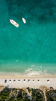 Aerial view of two yachts moored close to a beach in Greece.