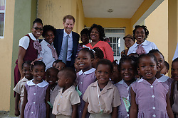 Kensington Palace handout photo of Prince Harry meeting schooldchildren from Half Way Tree Primary School in St Kitts after arriving on the island of St Kitts for the second leg of his Caribbean tour.