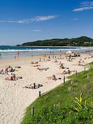 View of people enjoying the morning at Byron Bay Beach, Byron Bay, NSW, Australia