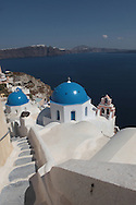 A walk in the town of Oia on the island of Santorini.  Photograph by Dennis Brack