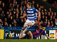 Photo: Daniel Hambury.<br />Crystal Palace v Reading. Coca Cola Championship.<br />20/01/2006.<br />Palace's Mark Hudson and Reading's Kevin Doyle battle for the ball.