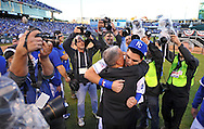 Oct 15, 2014; Kansas City, MO, USA; Kansas City Royals first baseman Eric Hosmer (35) hugs general manager Dayton Moore after game four of the 2014 ALCS playoff baseball game against the Baltimore Orioles at Kauffman Stadium. The Royals swept the Orioles to advance to the World Series. Mandatory Credit: Peter G. Aiken-USA TODAY Sports