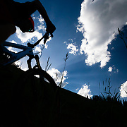 Andrew Whiteford silhouetted against the clouds near Teton Pass. Mail Cabin Trail.