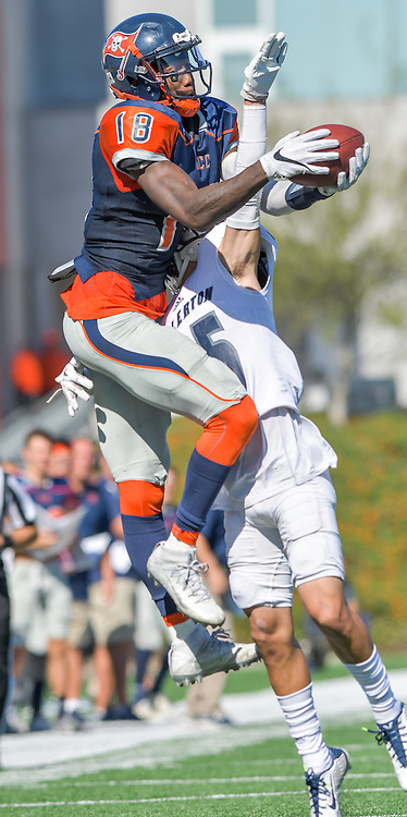 Costa Mesa, California --Orange Coast College Receiver James Rutledgel attempts to catch an incoming pass from a Fullerton College defender during Saturday's game at LeBard Stadium.