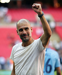 Manchester City manager Pep Guardiola celebrates his side's victory after the Community Shield match at Wembley Stadium, London.