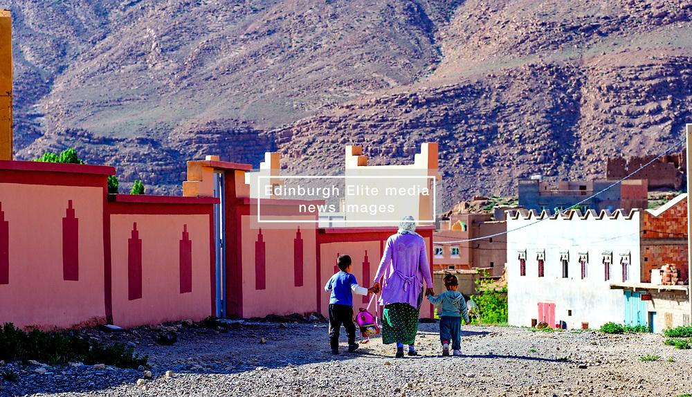 A woman taking her children to nursery in Tamtetoucht, Morocco<br /> <br /> (c) Andrew Wilson | Edinburgh Elite media