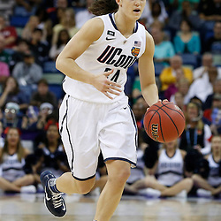 Apr 9, 2013; New Orleans, LA, USA; Connecticut Huskies guard Kelly Faris (34) dribbles against the Louisville Cardinals during the first half of the championship game in the 2013 NCAA womens Final Four at the New Orleans Arena. Mandatory Credit: Derick E. Hingle-USA TODAY Sports