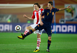 Esgar Barreto of Paraguay vs David Villa of Spain during the  2010 FIFA World Cup South Africa Quarter Finals football match between Paraguay and Spain on July 03, 2010 at Ellis Park Stadium in Johannesburg. (Photo by Vid Ponikvar / Sportida)