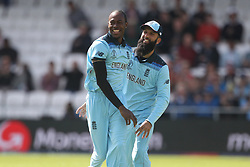 June 21, 2019 - Leeds, Yorkshire, United Kingdom - Jofra Archer celebrates with Moeen Ali after dismissing Sri Lanka's Dimuth Karunaratne during the ICC Cricket World Cup 2019 match between England and Sri Lanka at Headingley Carnegie Stadium, Leeds on Friday 21st June 2019. (Credit Image: © Mi News/NurPhoto via ZUMA Press)