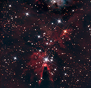 The dark Cone Nebula and the open Christmas Tree cluster (NGC 2264) in constellation Monoceros.