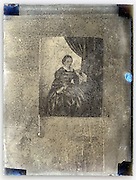 reproduction of an in the style of Vermeer painting on an eroding glass plate