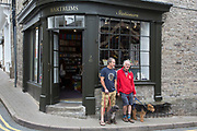 "Friends with their dogs caht outside a shop in Hay-on-Wye or Y Gelli Gandryll in Welsh, known as ""the town of books"", is a small town in Powys, Wales famous for it's many second hand and specialist bookshops, although the number has declined sharply in recent years, many becoming general antique shops and similar."