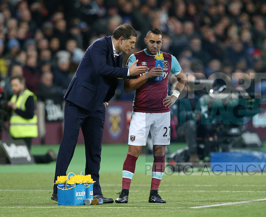 West Ham's Slaven Bilic speaks to Dimitri Payet during the Premier League match at the London Stadium, London. Picture date December 3rd, 2016 Pic David Klein/Sportimage