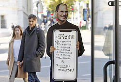 October 6, 2018 - Kiev, Kiev, Ukraine - Apple co-founder Steve Jobs portrait is seen with price list of Apple iPhone mobile phones in his hands, next  to a mobile phone shop in down town. (Credit Image: © Pavlo Gonchar/SOPA Images via ZUMA Wire)