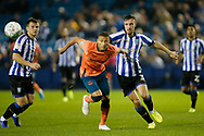 Richarlison of Everton and Morgan Fox of Sheffield Wednesday contest a loose ball  during the EFL Cup match between Sheffield Wednesday and Everton at Hillsborough, Sheffield, England on 24 September 2019.