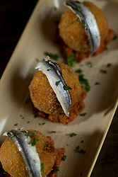 Detail of croquettas he bacalao (deep fried cod fish balls) at La Marchas Tapas Bar, photographed Wednesday, Jan. 13, 2016, in Berkeley, Calif. (Photo by D. Ross Cameron)