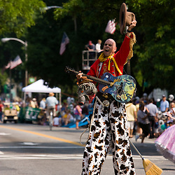 The Strolling of the Heiffers Parade in Brattleboro, Vermont.  Street performer.