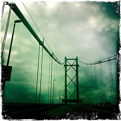 The Forth Road Bridge is a suspension bridge in east central Scotland. The bridge, opened in 1964, spans the Firth of Forth, connecting the capital city Edinburgh, at South Queensferry, to Fife, at North Queensferry..Hipstamatic images taken on an Apple iPhone..©Michael Schofield.