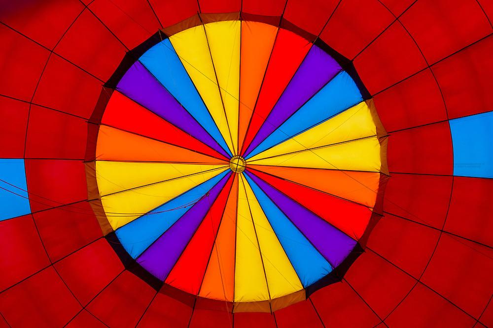 Interior view of hot air balloon envelope during inflation, Albuquerque International Balloon Fiesta, Albuquerque, New Mexico USA.