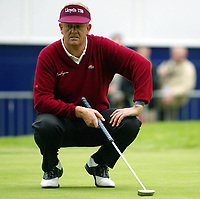 Photograph: Scott Heavey<br />Volvo PGA Championship At Wentworth Club. 23/05/2003.<br />Colin Montgomerie lines up a putt on the 18th.
