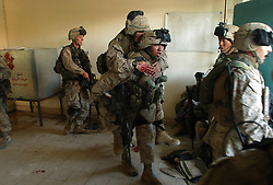 The Marines of Charlie Company 1st BN 4th Marines carry our a raid on the Najaf residence of Moqtada al-Sadr during the Battle of Najaf on August 12, 2004.<br />