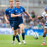 DUBLIN, IRELAND:  September 25:  Rory O'Loughlin #14 of Leinster wins the race for the loose ball from Lionel Mapoe #13 of the Bulls during the Leinster V Bulls United Rugby Championship match at Aviva Stadium on September 25th, 2021 in Dublin, Ireland. (Photo by Tim Clayton/Corbis via Getty Images)