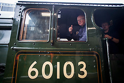 © Licensed to London News Pictures. 20/05/2021. London, UK. A train driver gives a thumbs up shortly before The LNER Flying Scotsman steam locomotive leaves Victoria Station in central London ahead of a tour through the Surrey Hills in South east England. The heritage steam locomotive touring season was mostly cancelled last year due to the Covid-19 pandemic but is now underway as restrictions are eased. Built in 1923 for the London and North Eastern Railway (LNER)It was the first steam locomotive to reach 100 miles per hour . Photo credit: Ben Cawthra/LNP