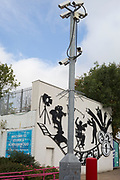 CCTV cameras look down on a bike storage area beneath the film industry being celebrated outside Elstree and Borehamwood train station, on 15th October 2019, in London, England.