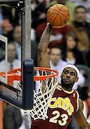 Cleveland Cavaliers' LeBron James goes eye-to-eye with the rim on his way up for a slam dunk during a game against the Washington Wizards at Quicken Loans Arena on Jan. 6, 2010 in Cleveland.