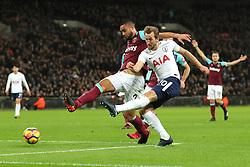 4 January 2018 - Premier League Football - Tottenham Hotspur v West Ham United - Harry Kane of Tottenham shoots past Winston Reid of West Ham - Photo: Charlotte Wilson / Offside