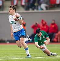 Italy's Paolo Garbisi evades the tackle of Ireland's Tom Stewart<br /> <br /> Photographer Bob Bradford/CameraSport<br /> <br /> The 2018 U18 6 Nations Festival - Ireland U18 v Italy U18 - Saturday 31st March 2018 - CCB Centre for Sporting Excellence, Ystrad Mynach Hengoed <br /> <br /> World Copyright © 2018 CameraSport. All rights reserved. 43 Linden Ave. Countesthorpe. Leicester. England. LE8 5PG - Tel: +44 (0) 116 277 4147 - admin@camerasport.com - www.camerasport.com