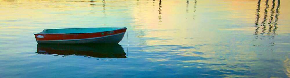 rowboat at anchor in Seabeck Bay, Hood Canal, Puget Sound, Washington state, USA