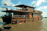 Le Bassac, a refubished teak rice barge today plies the waters of the Mekong on cruises from Saigon to Can Tho. The Mekong River is the world's 10th longest river running for over 4000 kilometers from the Tibetan Plateau through China's Yunnan province, Burma, Thailand, Laos, Cambodia and Vietnam.  The Mekong basin is one of the richest areas of biodiversity in the world. More than 1200 species of fish have been identified.  The difficulty of navigating the river has meant that it has divided rather than united the people who live near it.