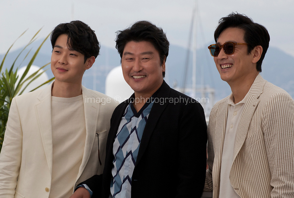 Song Kang-ho, Choi Woo-shik and Lee Sun-gyun at the Parasite film photo call at the 72nd Cannes Film Festival, Wednesday 22nd May 2019, Cannes, France. Photo credit: Doreen Kennedy