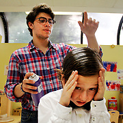 """Riverdale Rising Stars Summer Camp Broadway On the Hudson presents """"Thoroughly Modern Millie Junior."""" Seth Koffler as Maitre d' & a Cop & gets spayed down in hair spray backstage by Musical Director Ryan Esnard at the Riverdale YM-YWHA Neuwirth Theatre on August 7th, 2011."""