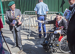 © Licensed to London News Pictures. 06/06/2014. Bayeux, Normandy. D Day veteran Len Bloomfield (93) rejoins a colleague as they made the short journey from Bayeux cathedral to the British Military service to attend a memorial as part of the 70th Anniversary D Day commemorations.   The veterans were met with rounds of applause and cheers by local crowds.   Also in attendance were HRH The Queen and Prince Phillip and various British political figures.  Photo credit : Alison Baskerville/LNP