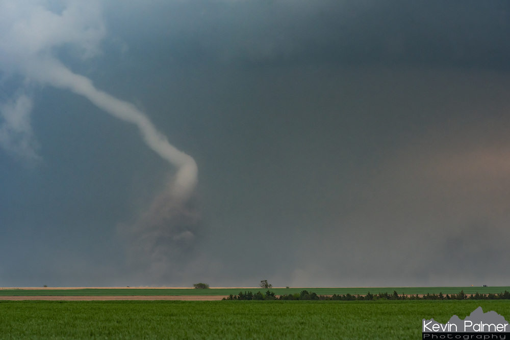 This dusty elephant trunk tornado dropped outside of McCook, Nebraska. It was one of many that formed from a long-track cyclic supercell. After firing on the dry line in Kansas, it tracked for nearly 200 miles. Researchers that are part of the TORUS project surrounded the twisters with a fleet of radar, drones, weather balloons, and other instruments. A NOAA P3 aircraft, which is typically used to fly into hurricanes, could be seen overhead circling this storm and gathering data. Altogether this was one of the most well studied and documented supercells yet. The tornadoes left some damage behind, including downed power lines across the road which ended my chase. But there were no reported injuries, which is always good news. Even though I wish I would have done some things differently, I'm just glad to have been there.