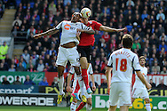Cardiff city's Rudy Gestede wins a header from Bolton's Zat Knight. NPower championship, Cardiff city v Bolton Wanderers at the Cardiff city Stadium in Cardiff, South Wales on Saturday 27th April 2013. pic by Andrew Orchard,  Andrew Orchard sports photography,