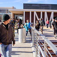Attendees spill out of the Student Services and Technology Center at UNM-Gallup Thursday when an over-capacity crowd forced a special bigfoot lecture to relocated across campus.